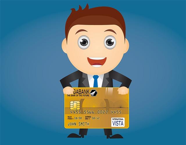 muž v obleku s kreditní kartou